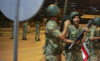 Turkish military block access to the Bosphorus bridge, which links the city's European and Asian sides, in Istanbul, Turkey, July 15, 2016.  REUTERS/Stringer - RTSI6U1