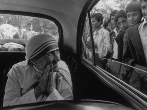INDIA. State of Assam. Town of Shillom. Mother TERESA being greeted during a visit to one of her missions. 1989.