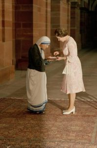 With heads bowed, the Queen and Mother Teresa look at the Insignia of the Honorary Order of Merit which Her majesty has just presented to the Lady of Calcutta, at the Rashtrapati Shavar, in New Delhi, Thursday, November 24, 1983. (AP Photo)