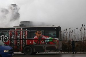 A bus passes by coal-fired power plants in Obilic, north of capital Pristina, Kosovo, February 2, 2017. Picture taken February 2, 2017. REUTERS/Hazir Reka