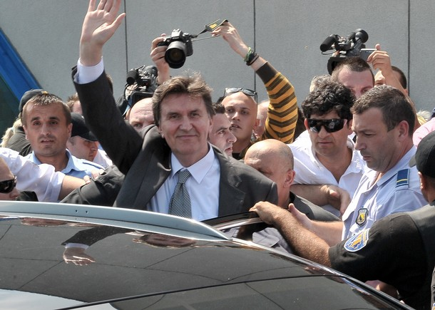 Former Bosnian leader Ejup Ganic waves on arrival to Sarajevo International Airport on July 28, 2010, after travelling from Britain following a British court's rejection of a Serbian bid to have him extradited on war crimes charges. Ganic was arrested at London's Heathrow airport in March as Serbia sought his extradition on charges of ordering a series of atrocities in Sarajevo in May 1992, at the outset of the three-and-a-half year Bosnian war. AFP PHOTO ELVIS BARUKCIC (Photo credit should read ELVIS BARUKCIC/AFP/Getty Images)